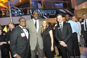 Michael Jordan accepted the Charlotte Business Journal's Business Person of the Year award at the Book of Lists Gala on Tuesday night. Here, he poses for photos with his wife, Yvette Prieto; William Wilson, CEO of William Wilson Clothing (left); and CBJ Publisher Kevin Pitts (right) and guests at the VIP reception.