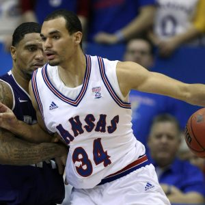 hi-res-162461384-perry-ellis-of-the-kansas-jayhawks-drives-to-the-goal_crop_exact
