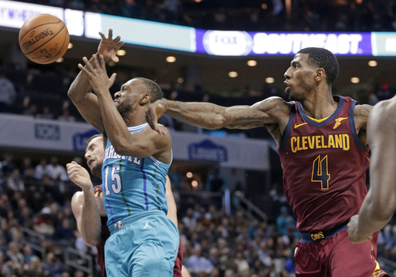 Charlotte Hornets  Kemba Walker (15) is fouled by Cleveland Cavaliers  Iman  Shumpert (4) during the first half Wednesday in Charlotte. cab83df1461c