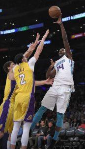 ... shoots as Los Angeles Lakers center Brook Lopez c48773affeb5