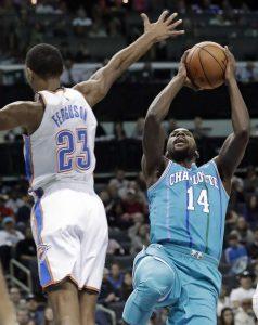 Charlotte Hornets  Michael Kidd-Gilchrist (14) shoots over Oklahoma City  Thunder s Terrance Ferguson (23) during the first half of an NBA basketball  game in ... e7b84d33e25e