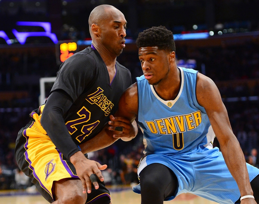 ... USA  Denver Nuggets guard Emmanuel Mudiay (0) dribbles the ball as Los  Angeles Lakers forward Kobe Bryant (24) defends in the first quarter of the  game ... 9f6af8a03832