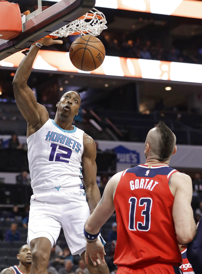 Charlotte Hornets  Dwight Howard (12) dunks past Washington Wizards  Marcin  Gortat (13) during the first half of an NBA basketball game in Charlotte 03075b76f8e1