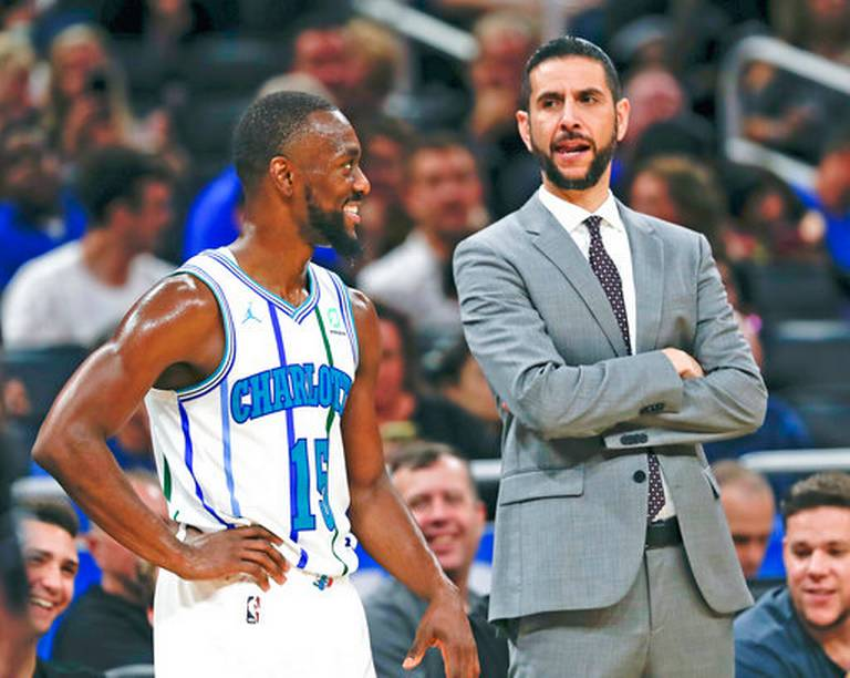 ... with head coach James Borrego while waiting for a teammate to shoot a  free throw against the Orlando Magic during the second half of an NBA  basketball ... 393392be59e2