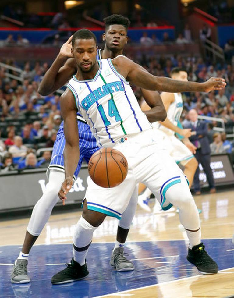Charlotte Hornets  Michael Kidd-Gilchrist (14) goes after the ball in front  of Orlando Magic s Mohamed Bamba during the first half of an NBA basketball  game ... 811b6e5bec58