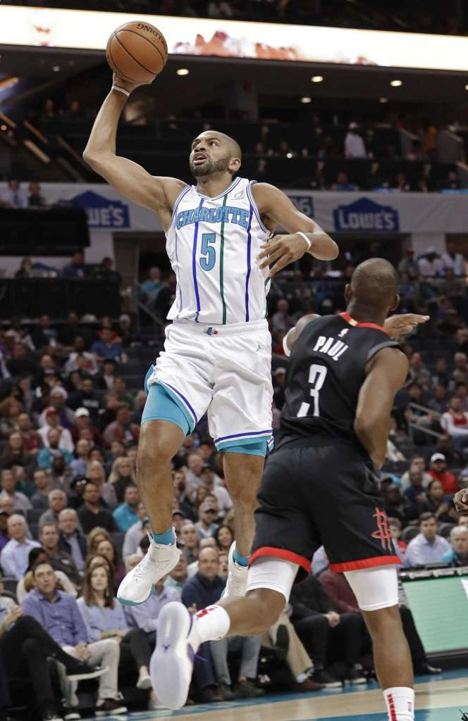 Charlotte Hornets  Nicolas Batum (5) drives against Houston Rockets  Chris  Paul (3) during the first half of an NBA basketball game in Charlotte 1fda62682601
